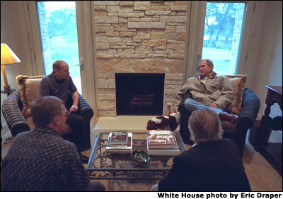 President George W. Bush and Russian President Vladimir Putin begin their first meeting at the Bush Ranch in Crawford, Texas, Wednesday, Nov. 14, 2001. Also pictured at bottom are Russian and American interpreters. White House photo by Eric Draper.