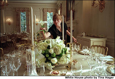 With just a few, short hours to go, Chief Florist Nancy Clarke makes sure a floral centerpiece consisting of Hydrangeas, White Lilies, White Roses and Limes is just right. White House photo by Tina Hager.