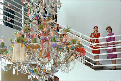 While their presidential husbands raised a raucous with an enthusiastic crowd in Toledo, Ohio, Martha Sahagun de Fox and Mrs. Laura Bush made a quiet, stately tour of an exhibit of Latino art at Chicago's Terra Museum of American Art. White House photo by Moreen Ishikawa.
