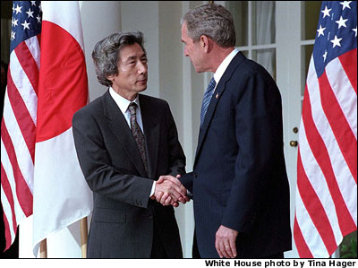 "President Bush and Japanese Prime Minister Junichiro Koizumi conduct a joint press conference in the Rose Garden Sept. 25. ""We Japanese are ready to stand by the United States to fight terrorism,"" said the Prime Minister."