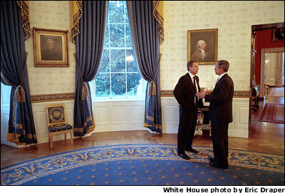 A few hours before addressing Congress and the nation, President Bush talks privately with British Prime Minister Tony Blair in the Blue Room at the White House Sept. 20. WHITE HOUSE PHOTO BY ERIC DRAPER