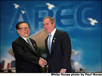 Presidents Bush and Jiang Zemin of China talk during the APEC economic summit in Shanghai, China, Oct. 21.