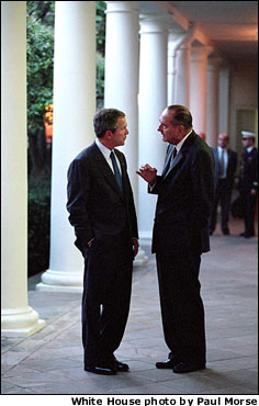 Walking along the West Wing Colonnade, President Bush and French President Jacque Chirac discuss current matters Sept. 18.