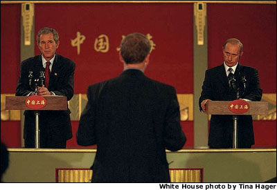 Presidents Bush and Putin hold a joint press conference during the APEC economic summit in Shanghai, China, Oct. 21. In the hours following the attacks, President Putin called President Bush and said that a moment of silence for America would be held throughout Russia, and that all flags should be lowered to half-staff, said White House Press Secretary Ari Fleischer. WHITE HOUSE PHOTO BY TINA HAGER.