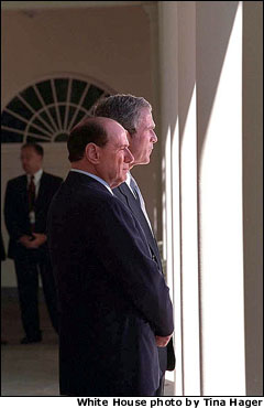 "President George Bush and Italy's Prime Minister Silvio Berlusconi walk together along the colonnade outside of the Oval Office Oct. 15. ""This attack was an attack not only against citizens, but also against freedom and liberty,"" said the visiting Prime Minister. White House photo by Tina Hager."