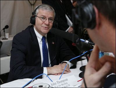 "White House Chief of Staff Joshua Bolten talks with radio host John ""JT"" Thompson of WSBT Radio in South Bend, Ind., during the White House Radio Day Tuesday, Oct. 24, 2006."