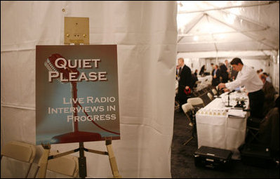 A sign requesting quiet is displayed at the entrance to the radio interview area at the White House, as radio journalist attend the White House Radio Day Tuesday, Oct. 24, 2006.