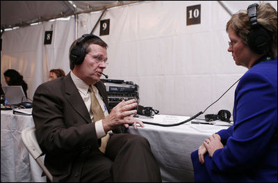 Secretary Michael O. Leavitt of the Department of Health and Human Services, speaks with radio journalist Sue Henry of radio station WILK in Scranton, Wilkes Barre, Pa., at White House Radio Day Tuesday, Oct. 24, 2006.