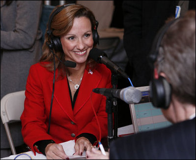 Fran Townsend, Assistant to the President for Homeland Security, talks with a radio journalist during the White House Radio Day Tuesday, Oct. 24, 2006.