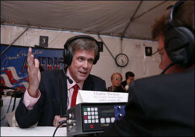 White House Press Secretary Tony Snow speaks with radio host Charlie Thomas of KDRO radio from Sedalia, Mo., during the White House Radio Day event Tuesday, Oct. 24, 2006 in Washington, D.C.