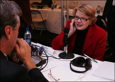 U.S. Department of Education Secretary Margaret Spellings holds an audio earpiece to her ear as she takes questions during the White House Radio Day event Tuesday, Oct. 24, 2006 in Washington, D.C.