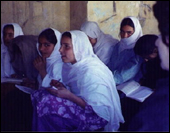 Afghan women reading and writing