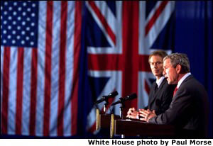 President George W. Bush appears with British Prime Minister Tony Blair at a press conference at Crawford High School in Crawford, Texas on April 6, 2002.