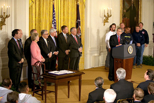 President George W. Bush speaks during the signing of the Terrorism Risk Insurance Act in the East Room, Tuesday, Nov. 26. 'The Terrorism Risk Insurance Act will provide coverage for catastrophic losses from potential terrorist attacks. Should terrorists strike America again, we have a system in place to address financial losses and get our economy back on its feet as quickly as possible,' said the President.