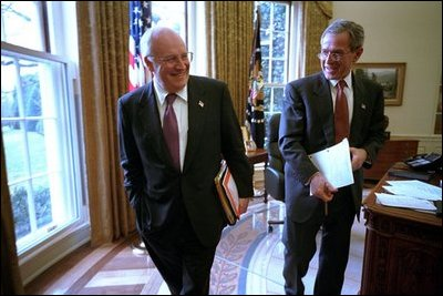 Vice President Dick Cheney and President George W. Bush joke with each other after a meeting in the Oval Office Jan. 24, 2002.