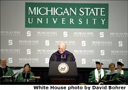 "After receiving an honorary doctorate degree from Michigan State University in Lansing, Mich., Vice President Dick Cheney speaks at the university's Undergraduate Convocation Ceremony May 3, 2002. ""This day will stand out as a marker of gifts well used, aspirations fulfilled, and hard work rewarded. I congratulate each of you, and hope your future is filled with the kind of happiness you feel today,""said the Vice President. White House photo by David Bohrer."