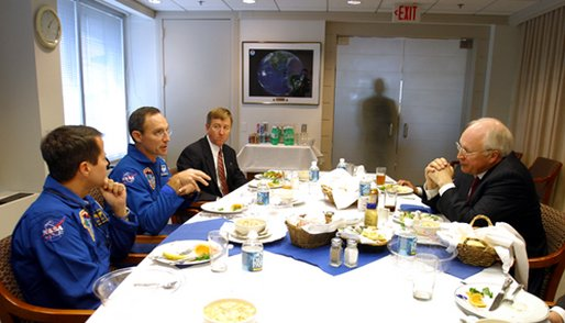 Vice President Dick Cheney meets with astronauts Dan Bursch, left, Carl Walz, center, Frank Culbertson and NASA Administrator Sean O'Keefe, who is not pictured, at NASA Headquarters in Washington, D.C., Wednesday, Nov. 20. Mr. Bursch and Mr. Walz hold the U.S. space endurance record for spending 196 days in space. White House photo by David Bohrer