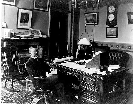 Black And White Photo Of Then Vice President Theodore Roosevelt Sitting At His Desk In The