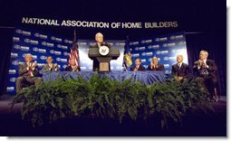 Joined on stage by Secretary of Housing and Urban Development Mel Martinez (second on left), Vice President Dick Cheney speaks to the National Association of Home Builders at the Washington Hilton Hotel in Washington, DC June 6, 2002. White House photo by David Bohrer.