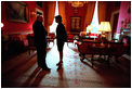 Vice President Dick Cheney and National Security Advisor Dr. Condoleezza Rice talk in the Red Room Feb. 13, 2002.