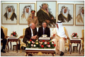 Vice President Dick Cheney joins Amir Hamad bin Khalifa Al-Thani of Qatar, right, and translator Gamal Helal, center, in a private meeting at Wajbah Palace in Doha, Qatar, March 17.