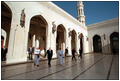 During his visit to Muscat, Oman, Vice President Dick Cheney passes under pointed arches and ornate engravings during a tour of the country's massive Grand Mosque, which spans an area of about 25 square miles, March 16.