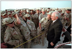 Troops at Al-Udeid Airbase in Qatar gather around Vice President Dick Cheney for pictures and handshakes March 17.