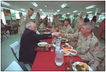 Stationed in Egypt, American troops are participating in an 11-country international peacekeeping force called the Multinational Force of Observers. Here, they share conversation and lunch with Vice President Dick Cheney during his visit to the base March 13. The MFO is an international peacekeeping force established by Egypt and Israel to monitor the security arrangements of their Treaty of Peace.