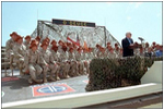 "Vice President Dick Cheney addresses the Arkansas National Guard Troops in Sharm El-Sheikh, Egypt, March 13. ""You, and everyone around you, are doing your duty and reflecting credit on yourselves, your families, and your country,"" said the Vice President during a speech at the Airbase. ""You're here because you believe in America, and America believes in you."""